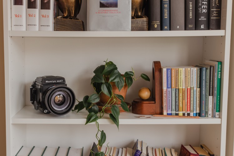 Maybe you can declutter a bookcase or add a picture of a loved one.